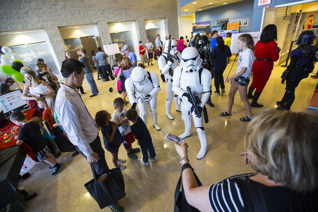 """Children interact with members of the 501st Legion during the """"May Science Be With You"""" event, held by the National Atomic Testing Museum and the Desert Research Institute, in La ..."""
