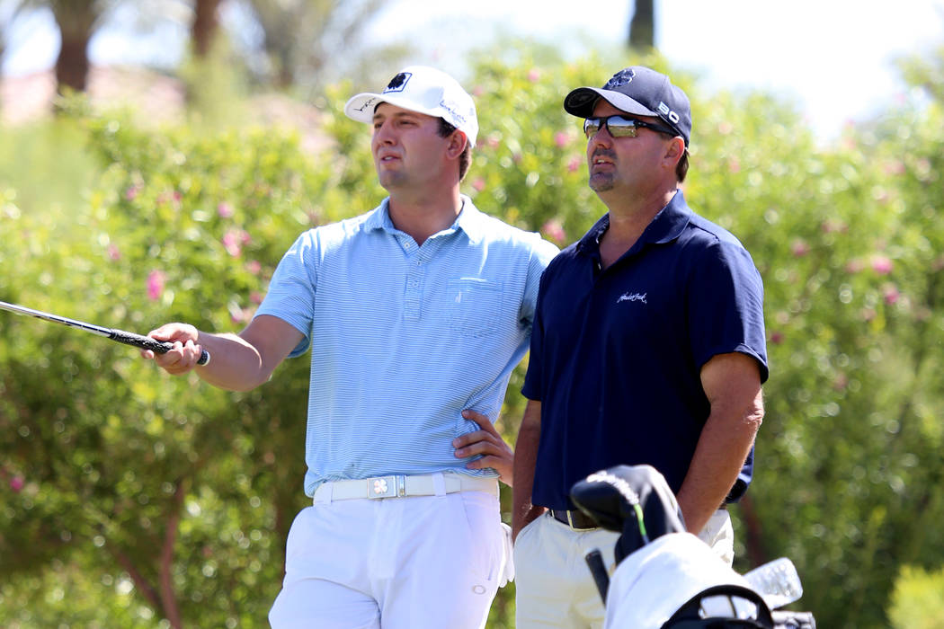 Taylor Montgomery, left, of UNLV and his father and caddie Monte Montgomery on the second hole during the U.S. Open qualifier at Southshore Golf Club  on Monday, May 8, 2017, in Henderson. Bizuaye ...