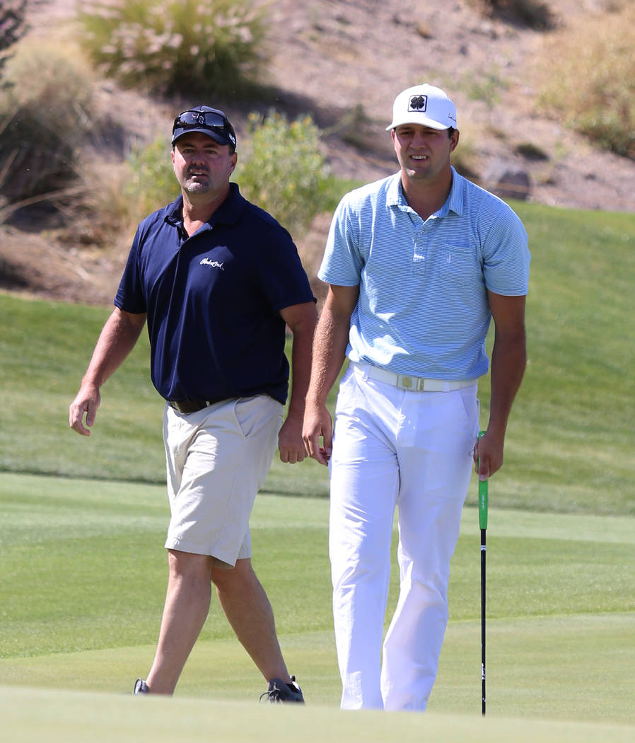 Taylor Montgomery, right, of UNLV and his father and caddie Monte Montgomery on the second hole during the U.S. Open qualifier at Southshore Golf Club  on Monday, May 8, 2017, in Henderson. Bizuay ...