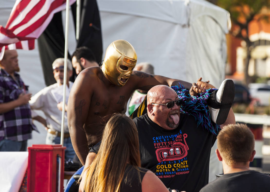 Mike Ross takes a photo with luchador Nacho Negro during the El Tiempo block party at Texas Station hotel-casino in North Las Vegas on Friday, May 5, 2017. Miranda Alam Las Vegas Review-Journal @m ...