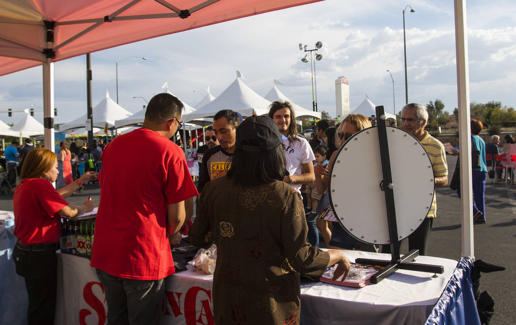 Attendees spin the wheel to win prizes at the Stations Casino booth at the El Tiempo block party at Texas Station hotel-casino in North Las Vegas on Friday, May 5, 2017. Miranda Alam Las Vegas Rev ...