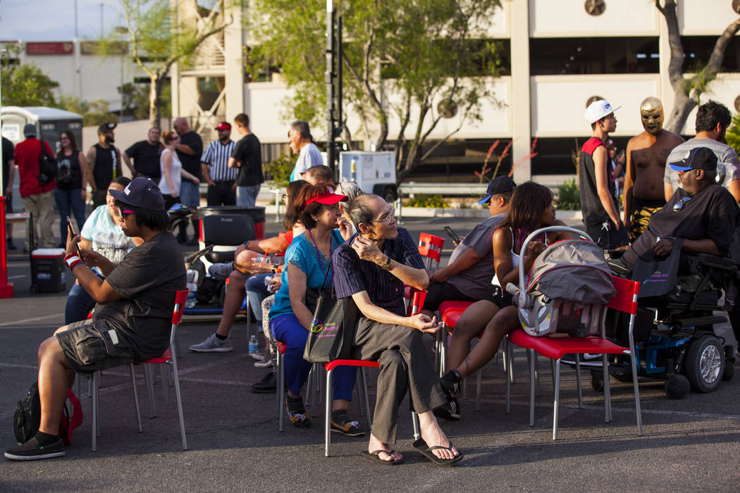 Attendees listen to live music while waiting for the luchador match to start during the El Tiempo block party at Texas Station hotel-casino in North Las Vegas on Friday, May 5, 2017. Miranda Alam  ...