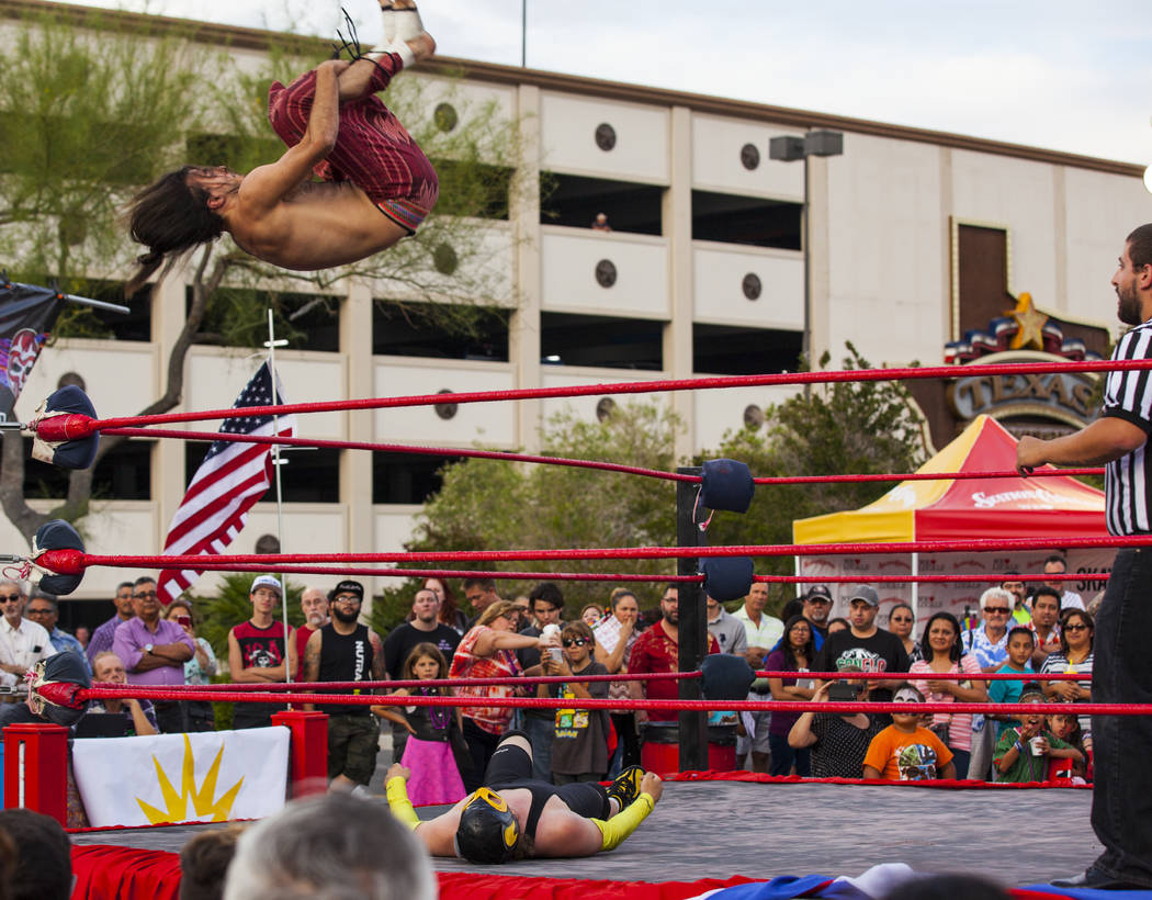 Attendees watch a luchador match during the El Tiempo block party at Texas Station hotel-casino in North Las Vegas on Friday, May 5, 2017. Miranda Alam Las Vegas Review-Journal @miranda_alam