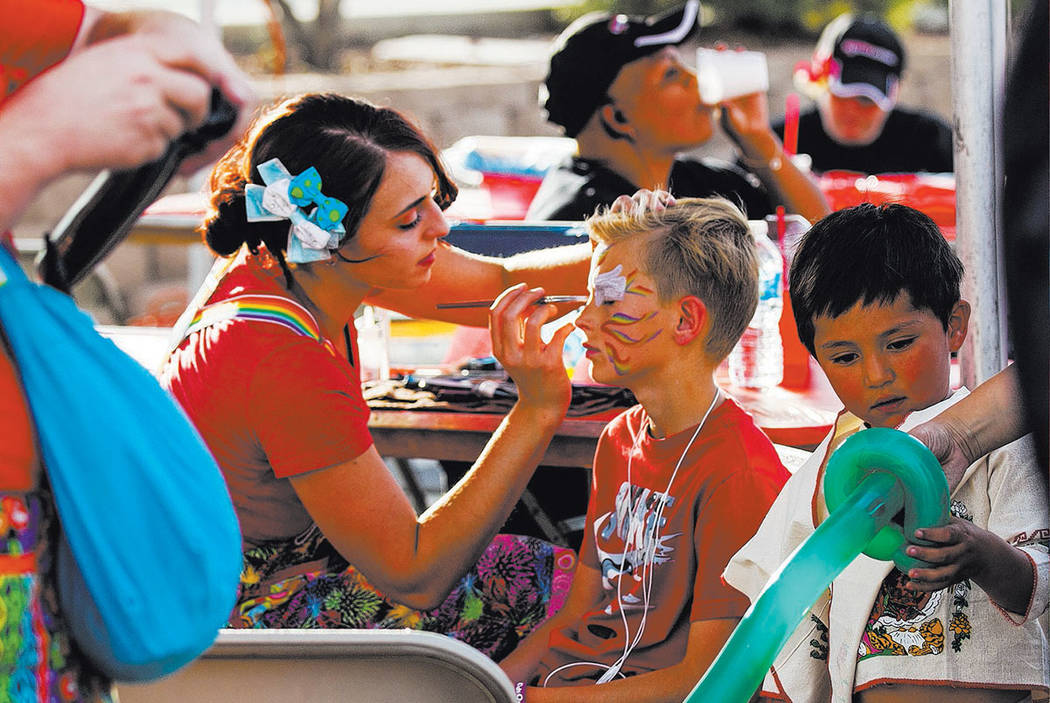 Jayce Turner, 11, gets his face painted by Ashly Azzurro during the El Tiempo block party at Texas Station hotel-casino in North Las Vegas on Friday, May 5, 2017. Miranda Alam Las Vegas Review-Jou ...