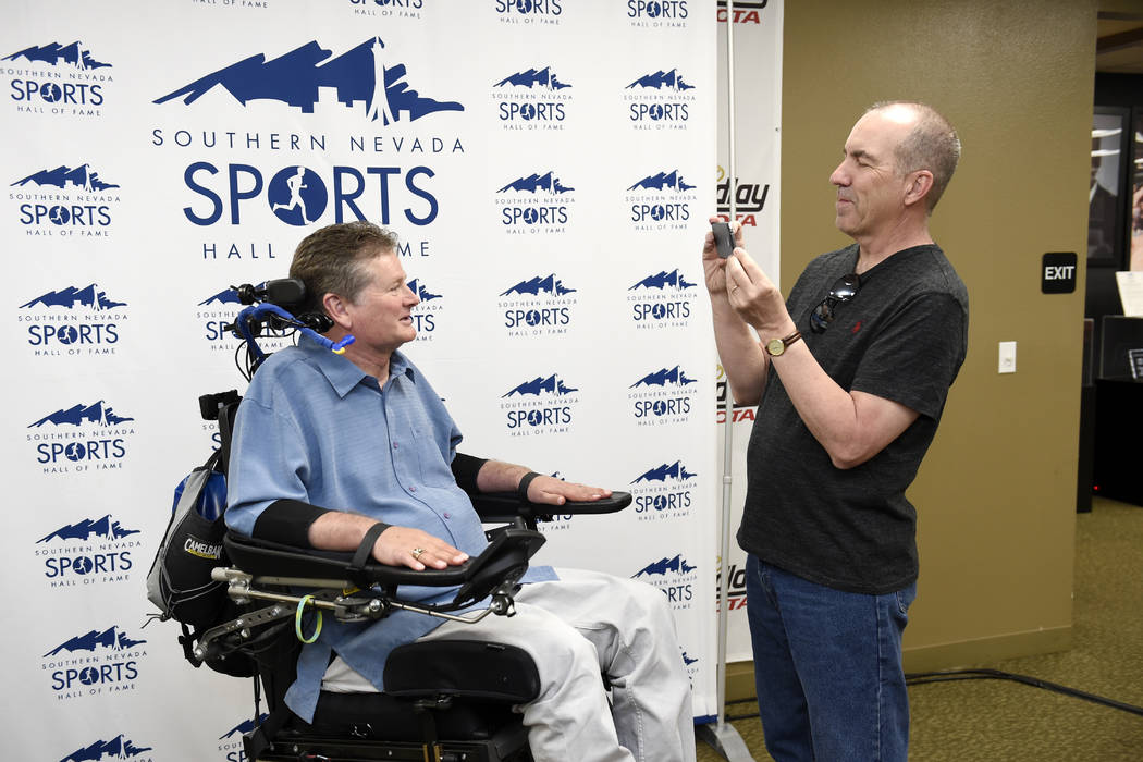 Las Vegas Review Journal Columnist Ron Kantowski interviews Sam Schmidt during a news conference to announce the 2017 inductees into the Southern Nevada Sports Hall of Fame Tuesday, March 14, 2017 ...