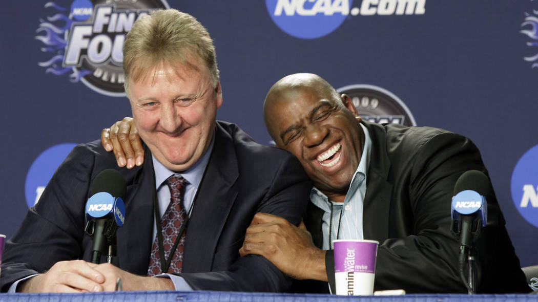 "In this April 6, 2009, file photo, former NBA players Earvin ""Magic"" Johnson, right, and Larry Bird share a laugh at a news conference before the championship game between Michigan State and North ..."