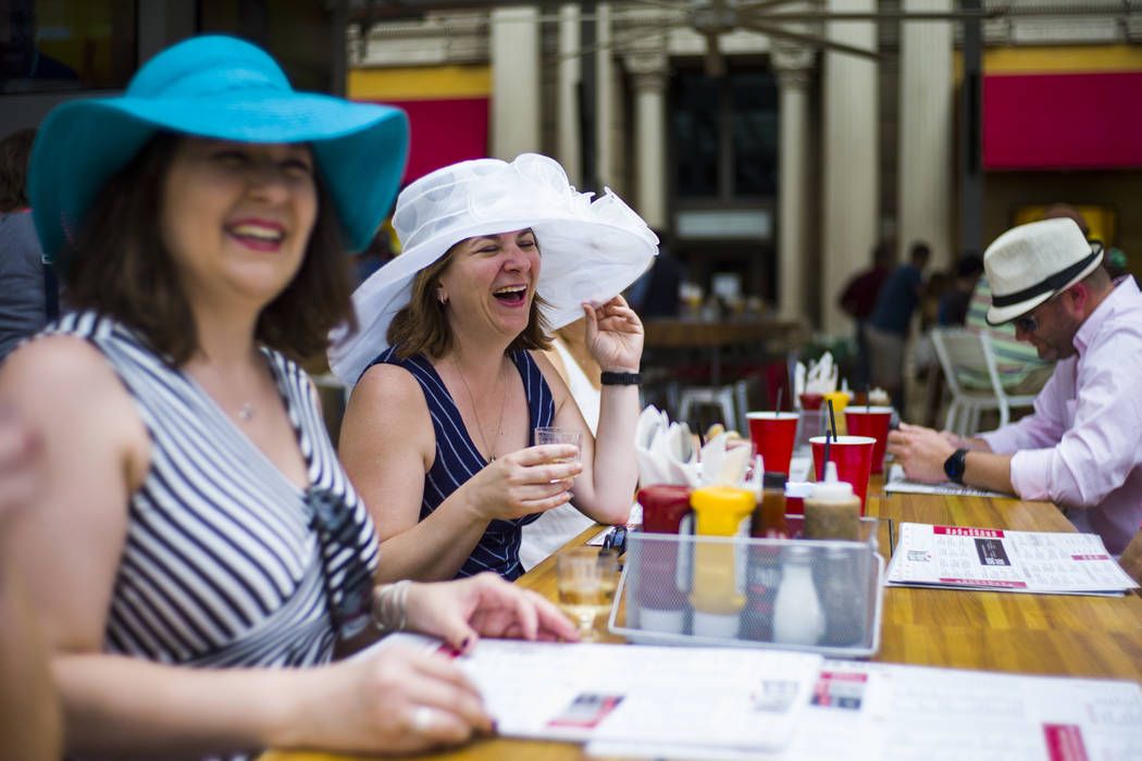 Deborah Knox, center, who was visiting Las Vegas to celebrate her birthday, during a Kentucky Derby viewing party at Beer Park at the Paris hotel-casino in Las Vegas on Saturday, May 6, 2017. Chas ...