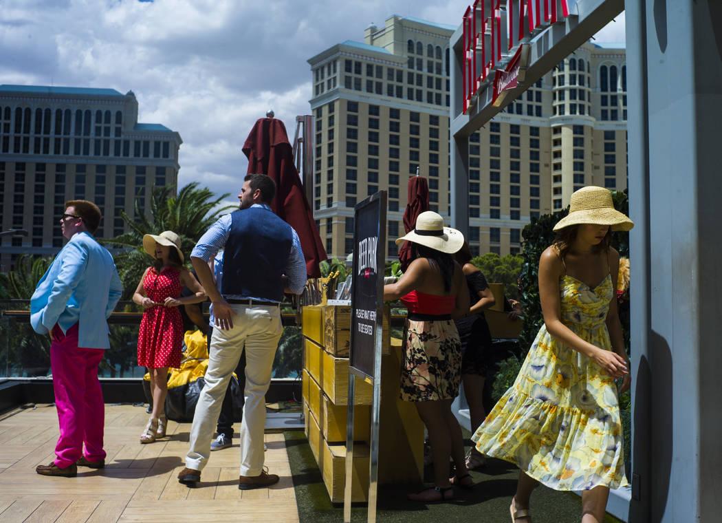 People arrive at Beer Park at the Paris hotel-casino for a Kentucky Derby viewing party in Las Vegas on Saturday, May 6, 2017. Chase Stevens Las Vegas Review-Journal @csstevensphoto