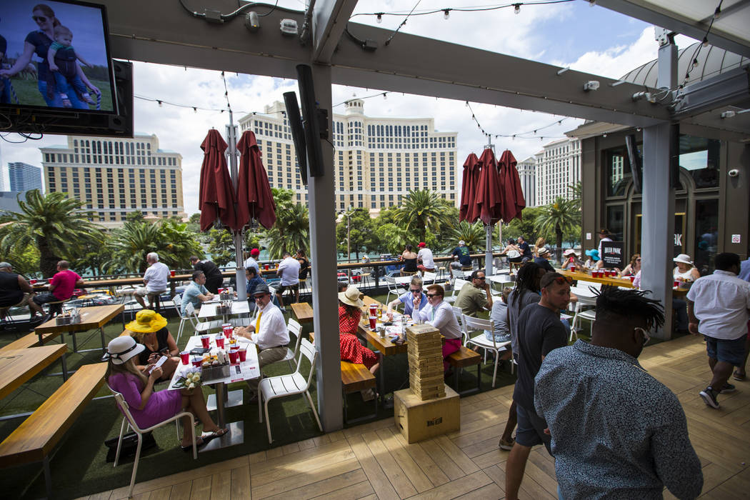 Attendees during a Kentucky Derby viewing party at Beer Park at the Paris hotel-casino in Las Vegas on Saturday, May 6, 2017. Chase Stevens Las Vegas Review-Journal @csstevensphoto