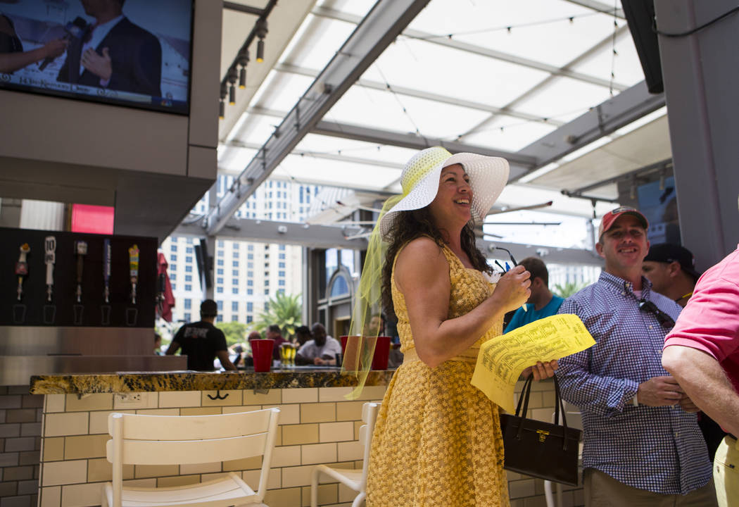Eleanor Alongi waits to place a bet during a Kentucky Derby viewing party at Beer Park at the Paris hotel-casino in Las Vegas on Saturday, May 6, 2017. Chase Stevens Las Vegas Review-Journal @csst ...