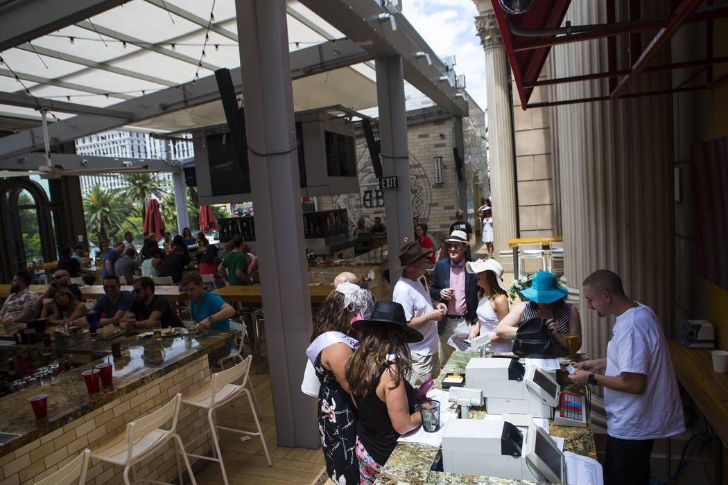 People place bets during a Kentucky Derby viewing party at Beer Park at the Paris hotel-casino in Las Vegas on Saturday, May 6, 2017. Chase Stevens Las Vegas Review-Journal @csstevensphoto