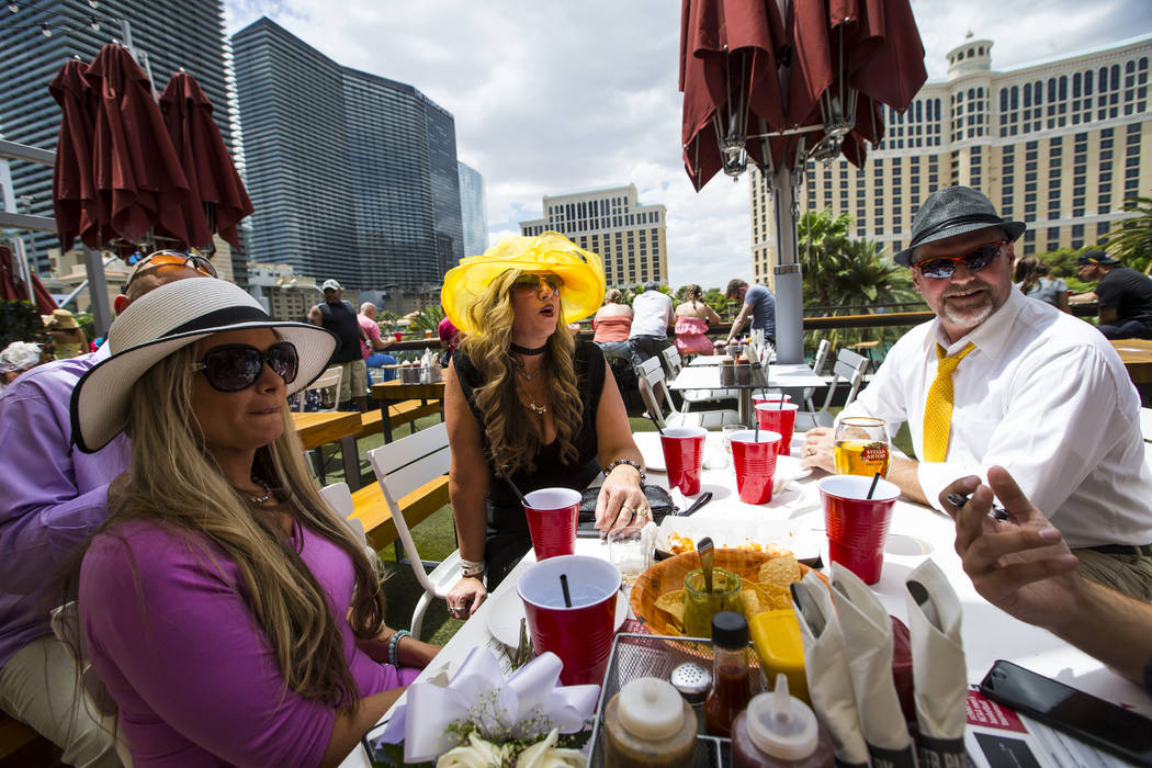 Jennifer Arledge, left, and Susan and Ed Rupert during a Kentucky Derby viewing party at Beer Park at the Paris hotel-casino in Las Vegas on Saturday, May 6, 2017. Chase Stevens Las Vegas Review-J ...