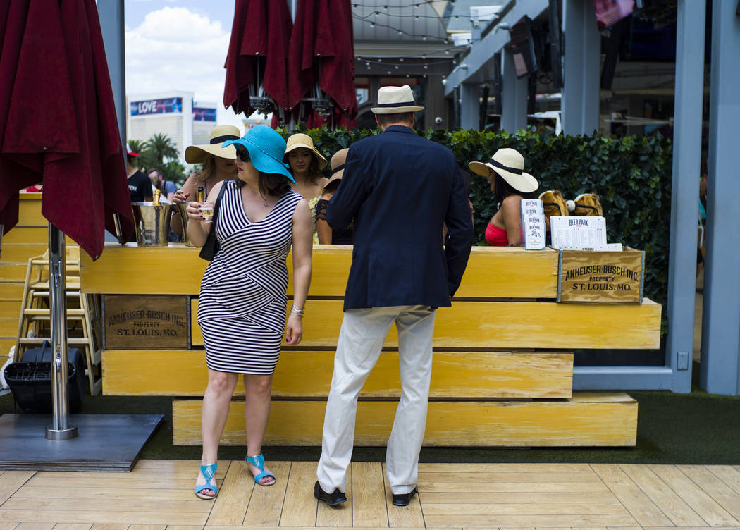 Tara Bird, left, and Joe Komer arrive at Beer Park at the Paris hotel-casino for a Kentucky Derby viewing party in Las Vegas on Saturday, May 6, 2017. Chase Stevens Las Vegas Review-Journal @csste ...