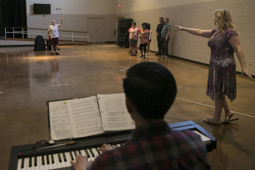 """Director Rebecca Morris, right, speaks to the cast during  a rehearsal of """"L'Etoile (The Star),"""" a comic opera set in outer space, at University Methodist Church on Wednesday, Ma ..."""