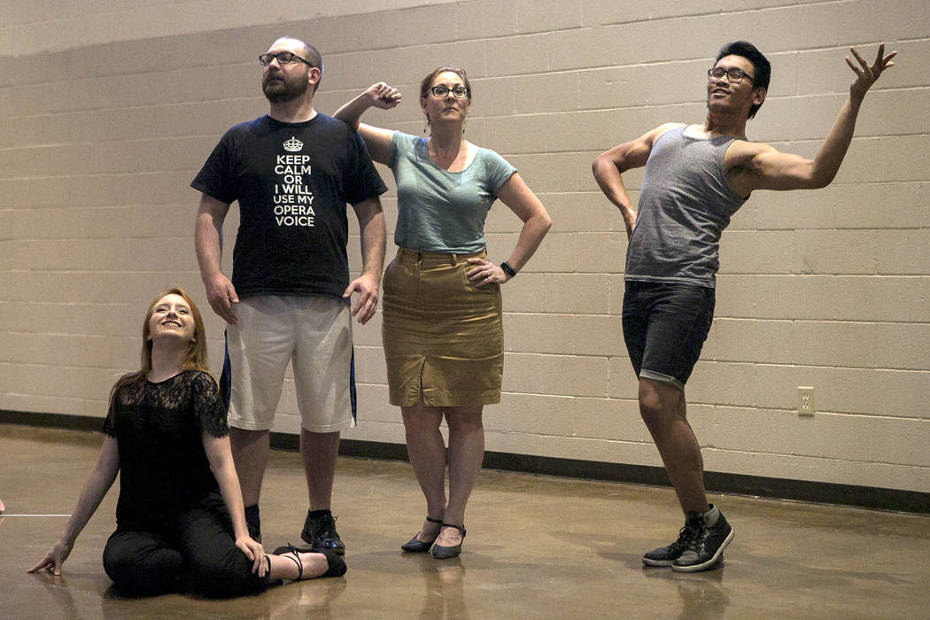 From left to right, Kayla Wilkens, playing Princess Laoula, Matthew Castleton, playing Herisson de Porc-Epic, Susan Easter, playing Aloes, and Miguel Alasco, playing Tapioca, rehearse a scene of & ...