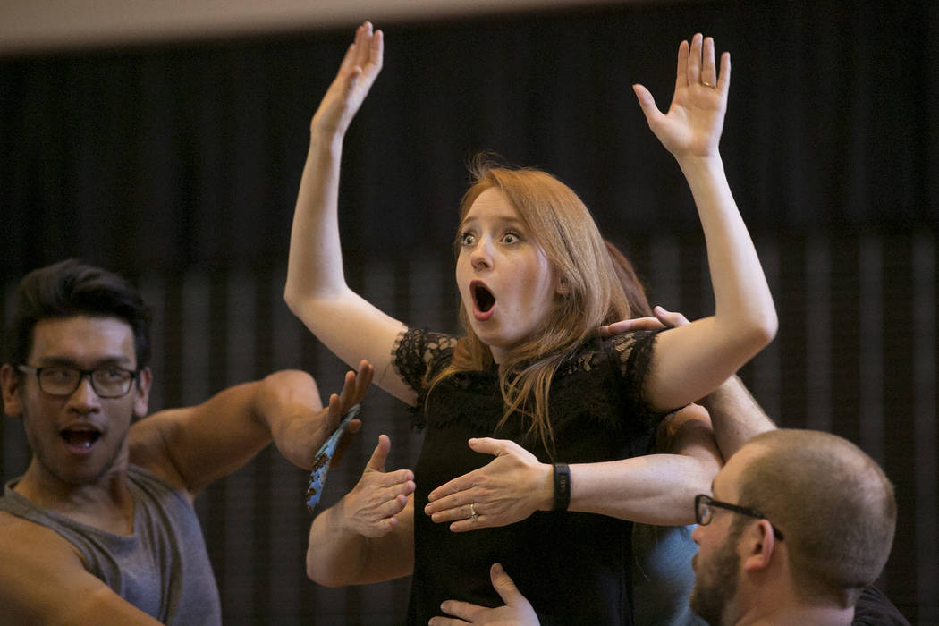 """Kayla Wilkens, playing Princess Laoula, center, rehearses a scene of """"L'Etoile (The Star),"""" a comic opera set in outer space, with cast members at University Methodist Church on Wednesday, May 3,  ..."""