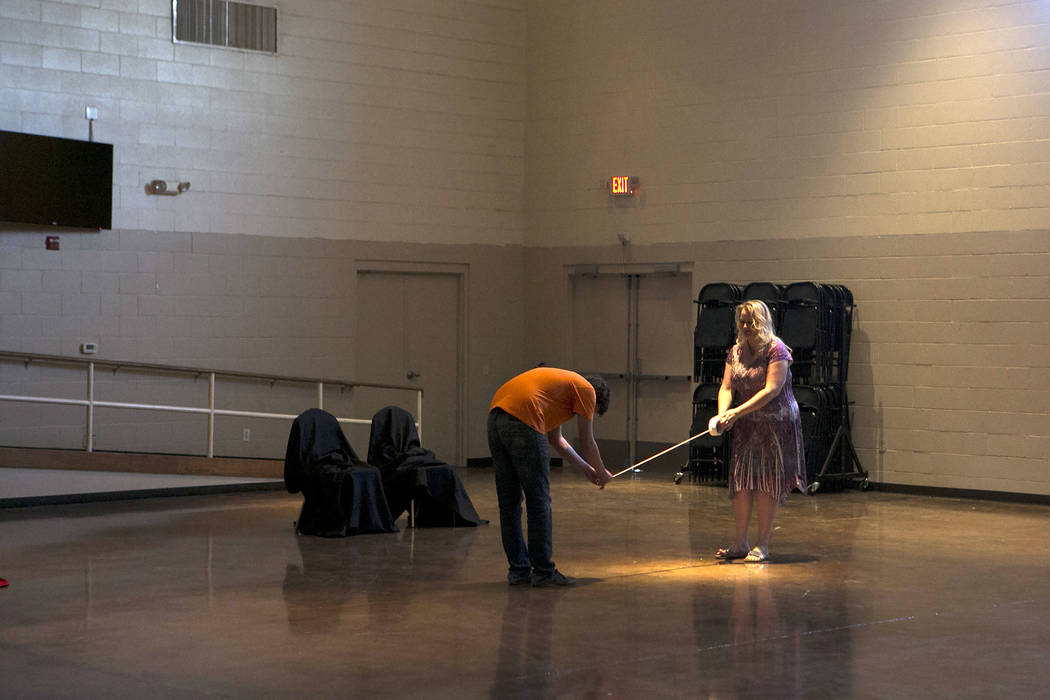 """Director Rebecca Morris, right, and cast member Nico Brissette, left, mark the floor in preparation for a rehearsal of """"L'Etoile (The Star),"""" a comic opera set in outer space, at ..."""