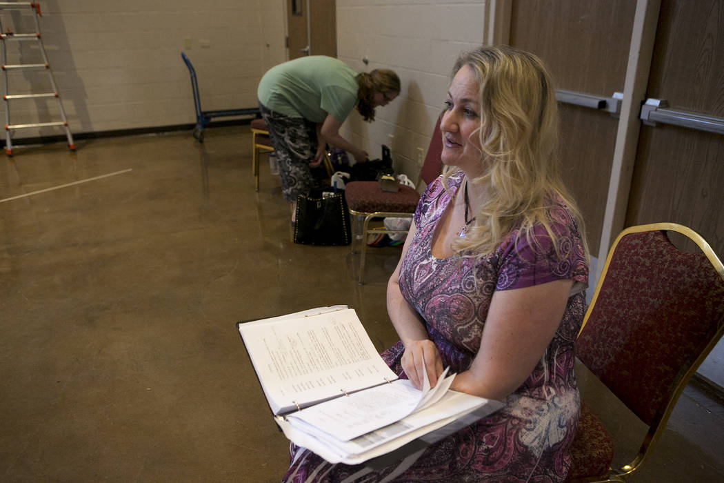 """Director Rebecca Morris, right, prepares for a rehearsal of """"L'Etoile (The Star),"""" a comic opera set in outer space, at University Methodist Church on Wednesday, May 3, 2017, in  ..."""
