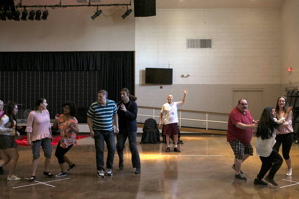 """John Hammel, center, playing King Ouf the First, practices a scene with other cast members during a a rehearsal of """"L'Etoile (The Star),"""" a comic opera set in outer space, at University Methodist  ..."""