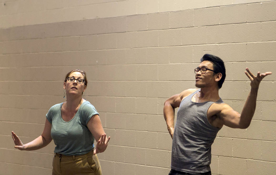 """From left to right, Susan Easter, who plays Aloes and Miguel Alasco, who plays Tapioca, rehearse a scene of """"L'Etoile (The Star),"""" a comic opera set in outer space, at University ..."""