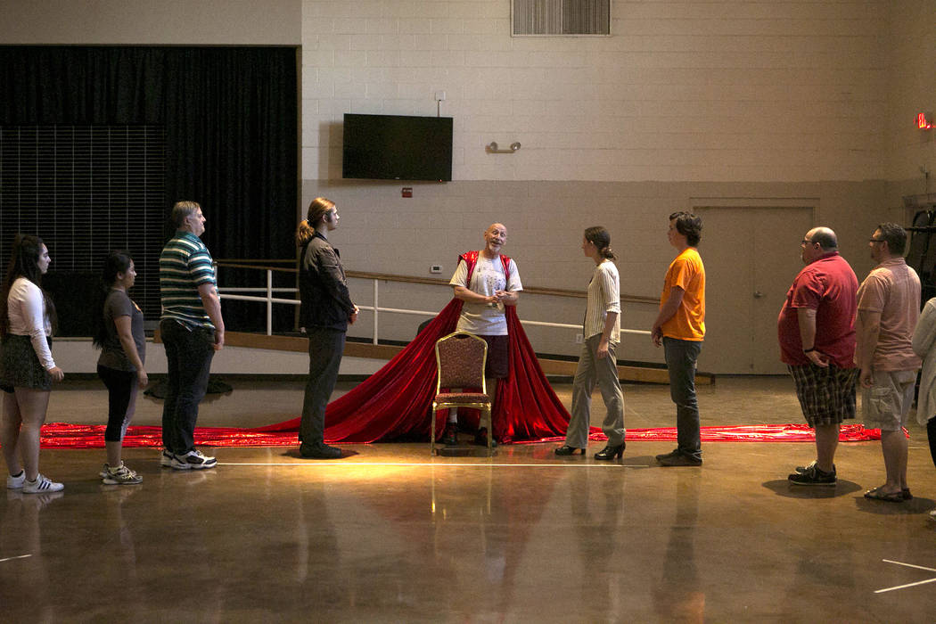 """John Hammel, center, playing King Out the First, practices a scene with other cast members during a a rehearsal of """"L'Etoile (The Star),"""" a comic opera set in outer space, at Uni ..."""