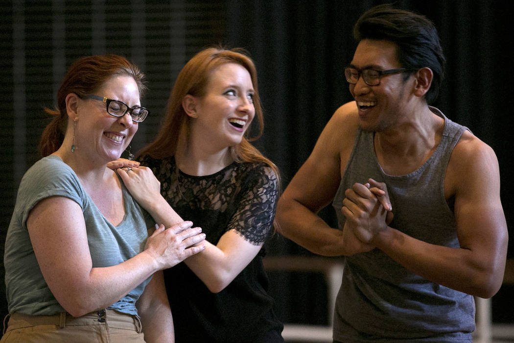 """From left to right, Susan Easter, playing Aloes, Kayla Wilkens, playing Princess Laoula, and Miguel Alasco, playing Tapioca, rehearse a scene of """"L'Etoile (The Star),"""" a comic op ..."""