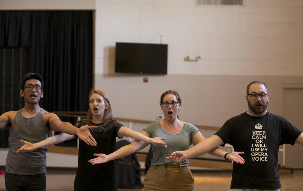 From left to right, Miguel Alasco, playing Tapioca, Kayla Wilkens, playing Princess Laoula, Susan Easter, playing Aloes, and Matthew Castleton, playing Herisson de Porc-Epic, rehearse a scene of & ...