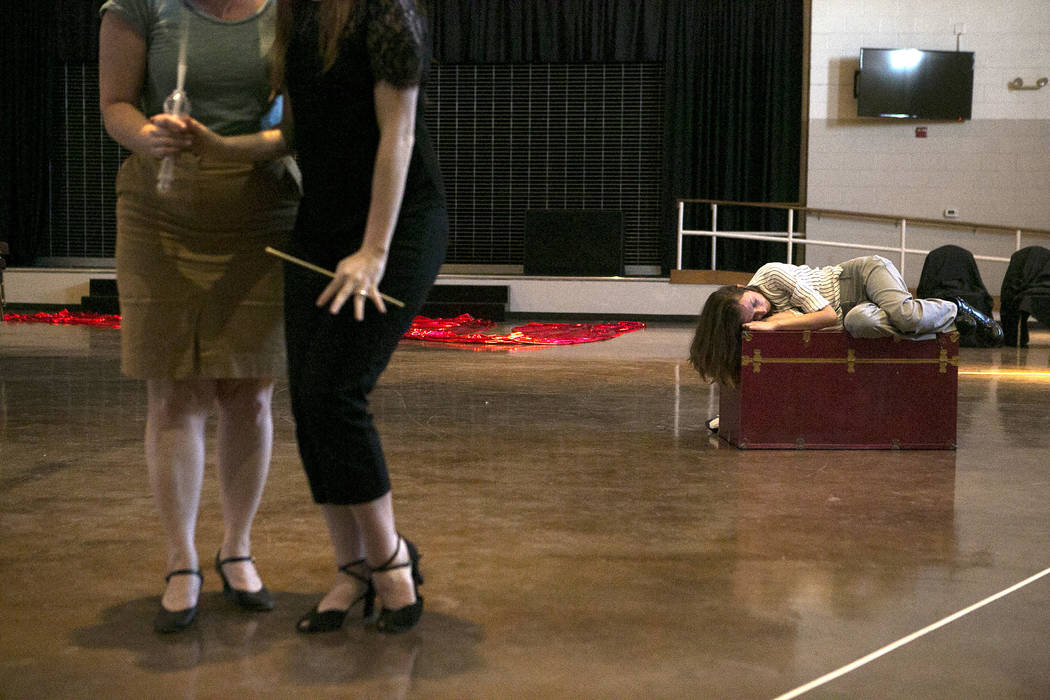 """From left to right, Susan Easter, playing Aloes, and Kayla Wilkens, playing Princess Laoula, and Lauren McAllister, playing Lazuli, rehearse a scene of """"L'Etoile (The Star),"""" a c ..."""