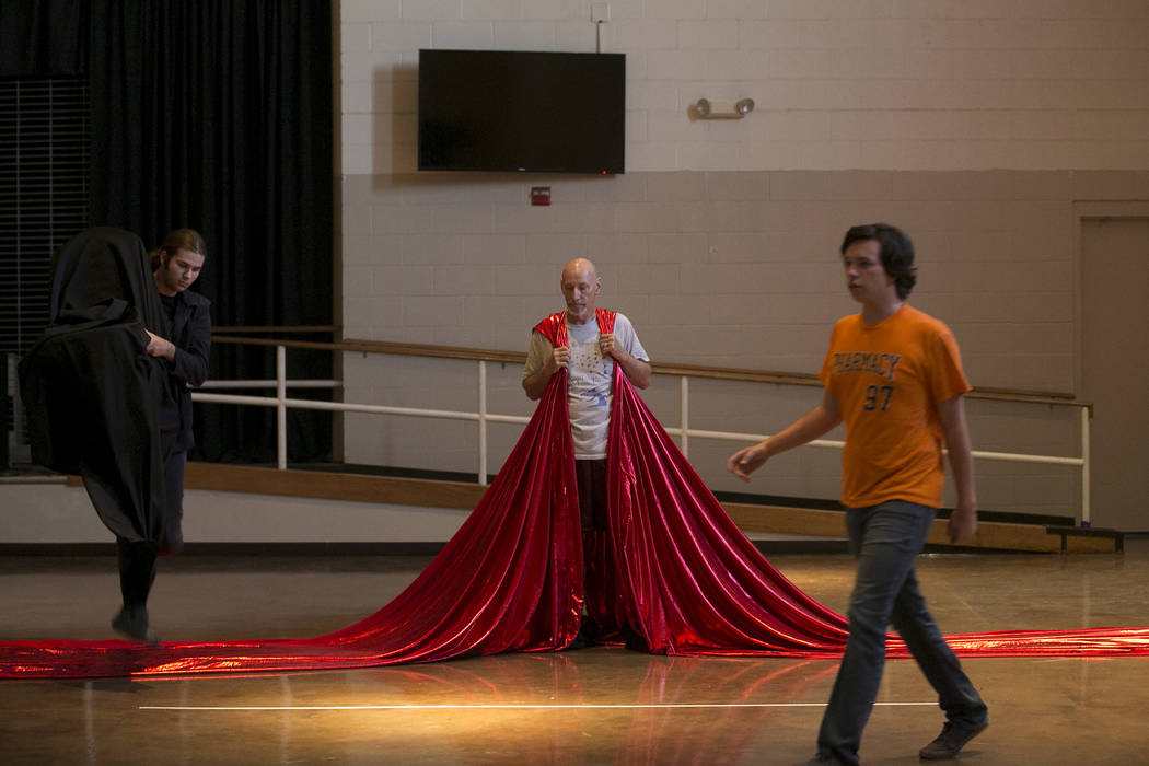 """John Hammel, center, playing King Out the First, prepares for  a scene with Meric Pittman, left, and Nico Brissette, right, during a rehearsal of """"L'Etoile (The Star),"""" a comic o ..."""