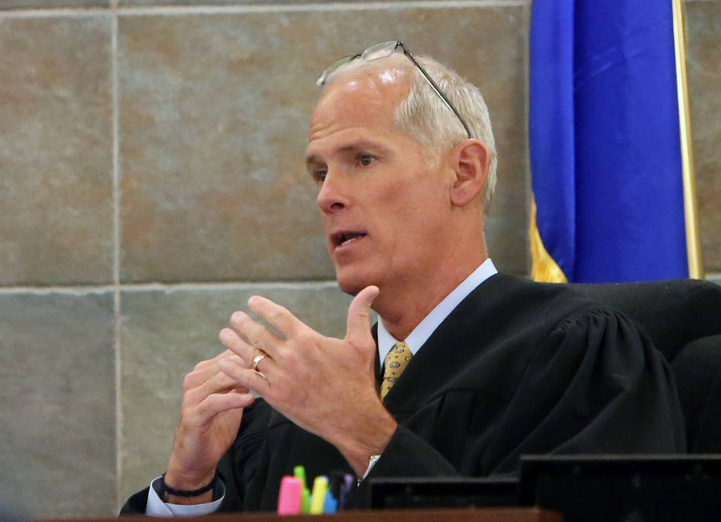 District Judge Douglas Herndon instructs the jury on Tuesday, May 2, 2017, at the Regional Justice Center, in the trial of Frederick Richards, a former Bellagio club host accused of drugging and r ...