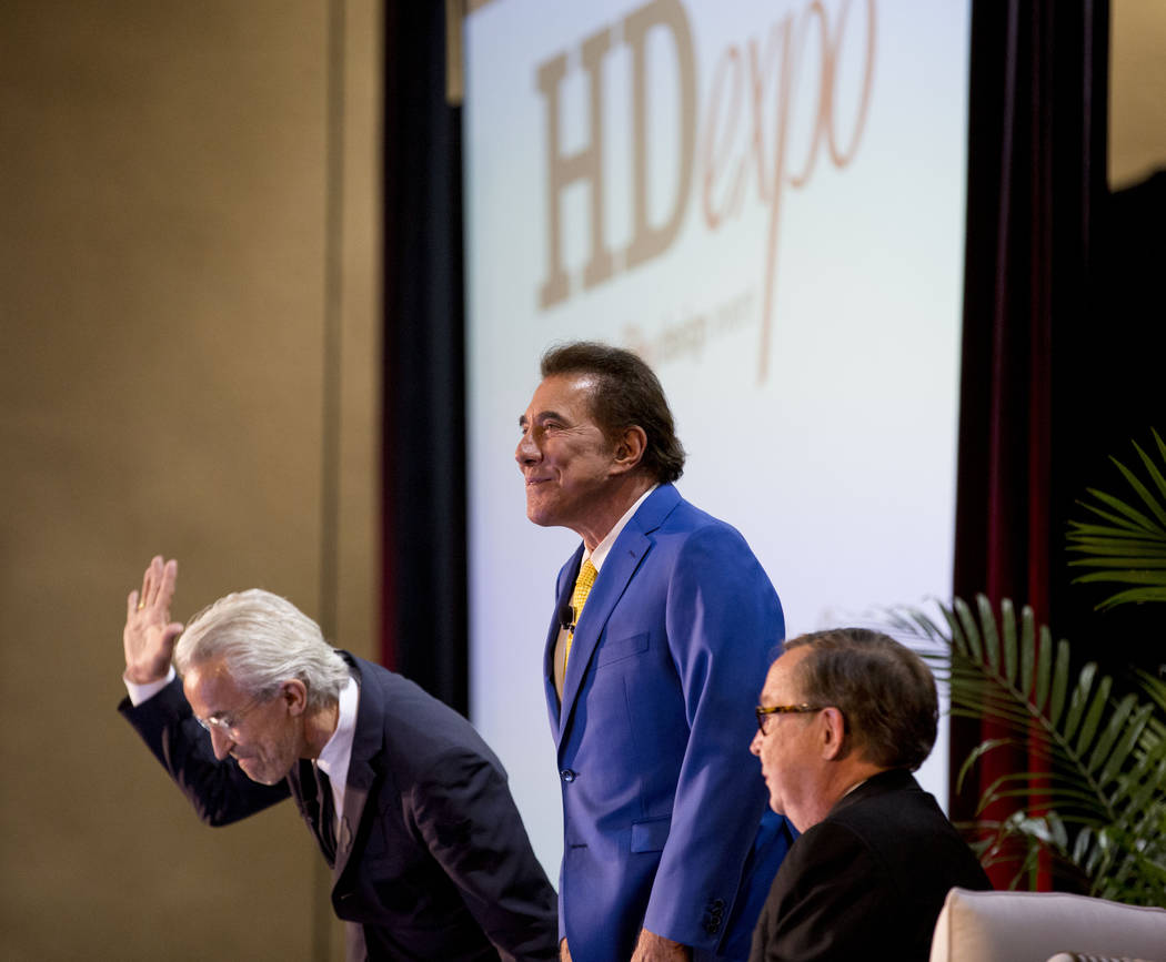 From left, designer Roger Thomas, casino resort developer Steve Wynn, and editor in chief at Hospitality Design Magazine Michael Adams at the Hospitality Design Exposition and Conference at the Ma ...