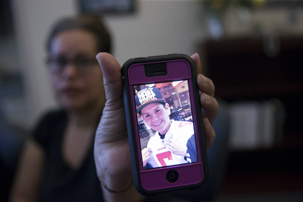 Edith Guzman shows a picture of her son Jose De Jesus Alatorre Guzman who was killed last year at the age of 19 while walking on the street, on Tuesday, May 9, 2017, in Las Vegas. The shooter has  ...