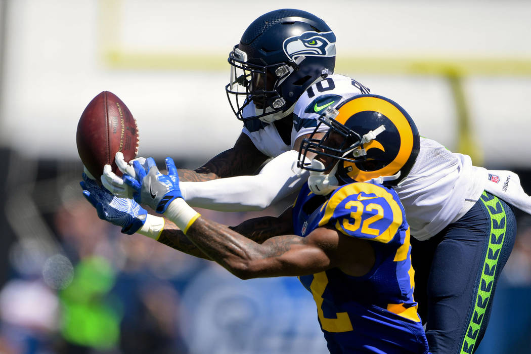 Sep 18, 2016; Los Angeles, CA, USA; Los Angeles Rams cornerback Troy Hill (32) breaks up a pass intended for Seattle Seahawks wide receiver Paul Richardson (10) during a NFL game at Los Angeles Me ...