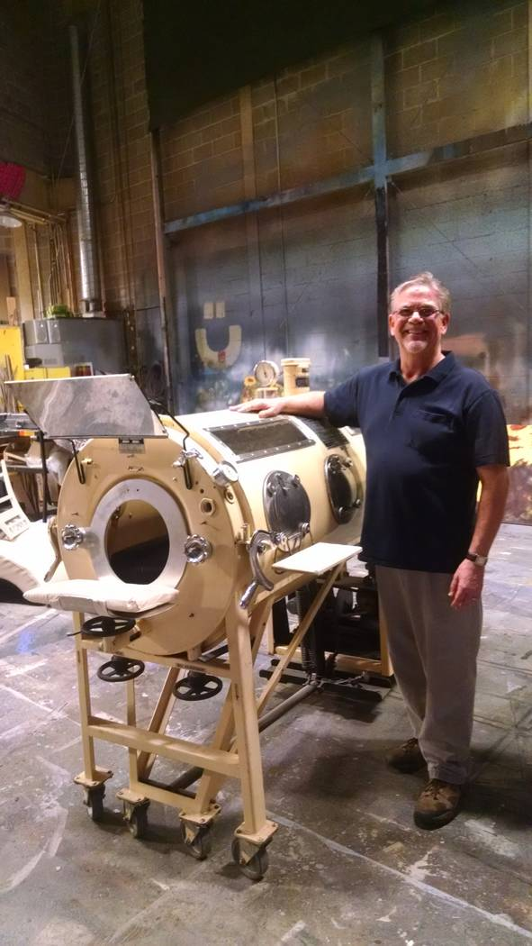 "Kent Stork beside the iron lung in which he spent most of his onstage time in the production of ""City of Angels"" at the Omaha Community Playhouse in April 2016. (Joyce Stork)"