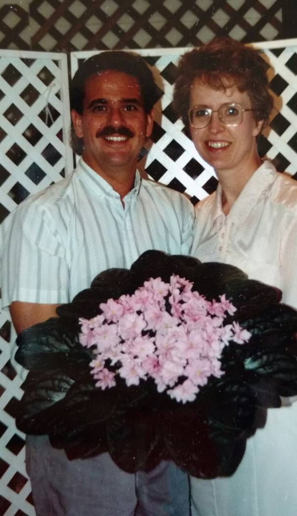 A photo from the 1980s of Kent and Joyce Stork with one of the largest African violets he had ever grown.  (Joyce Stork)