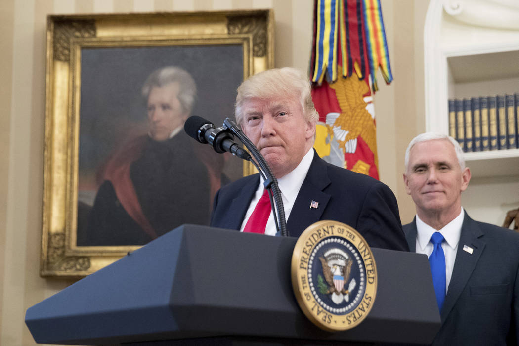 A portrait of former President Andrew Jackson hangs on the wall behind President Donald Trump, accompanied by Vice President Mike Pence on March 31, 2017, in the Oval Office at the White House in  ...