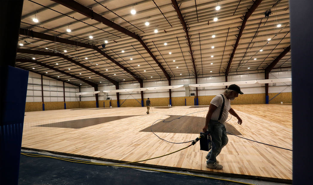 Men work in the field house under construction in Las Vegas, Friday, May 5, 2017. Chitose Suzuki Las Vegas Review-Journal @chitosephoto