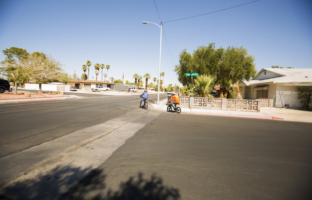 Two men bicycle at the corner of Rexford Drive and Oakey Boulevard. on Friday, Aug. 12, 2016, in the Beverly Green neighborhood. (Jeff Scheid/Las Vegas Review-Journal) Follow @jeffscheid