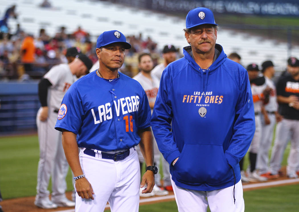 Las Vegas 51s manager Pedro Lopez (16) and pitching coach Frank Viola (34) at the start of their opening day game against the Fresno Grizzlies at Cashman Field in Las Vegas on Tuesday, April 11, 2 ...