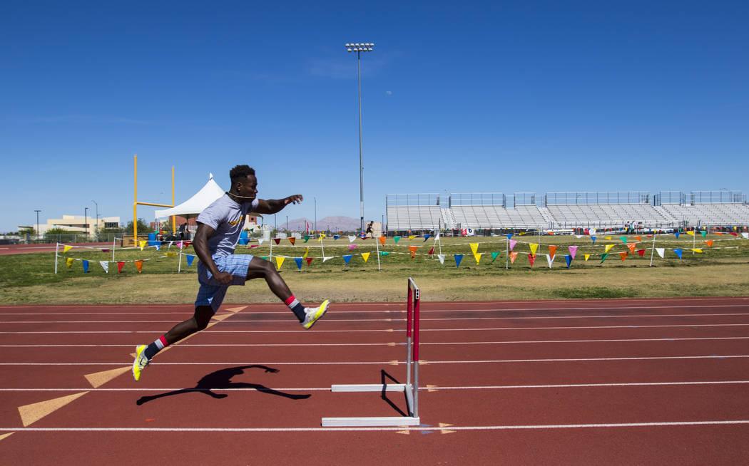 R.J. McCarter jumps hurdles during track practice at Bonanza High School in Las Vegas on Thursday, May 4, 2017. Miranda Alam Las Vegas Review-Journal @miranda_alam