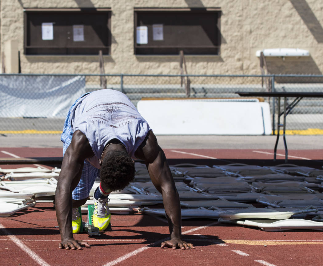 R.J. McCarter stretches during track practice at Bonanza High School in Las Vegas on Thursday, May 4, 2017. Miranda Alam Las Vegas Review-Journal @miranda_alam