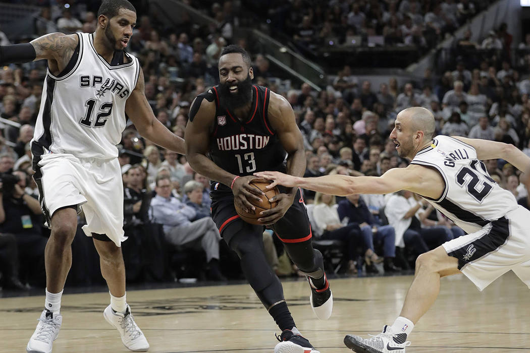 Houston Rockets guard James Harden (13) drives between San Antonio Spurs forward LaMarcus Aldridge (12) and guard Manu Ginobili (20) during the first half of Game 1 of a second-round NBA playoff s ...