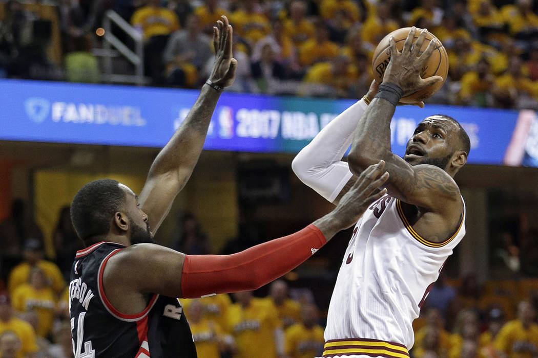 Cleveland Cavaliers' LeBron James, right, drives to the basket against Toronto Raptors' Patrick Patterson (54) in the first half in Game 1 of a second-round NBA basketball playoff series,, Monday, ...