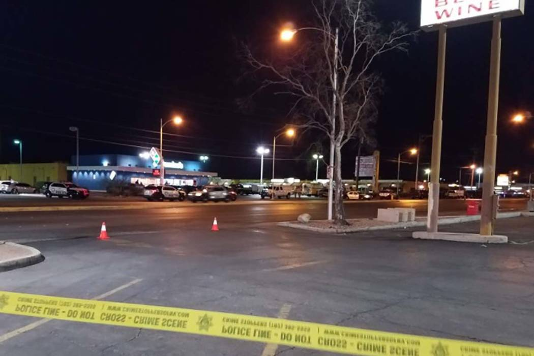 Las Vegas police take up positions near where a person was barricaded inside of a vehicle in the central Las Vegas Valley Tuesday morning. Traffic was blocked on South Maryland Parkway near East T ...