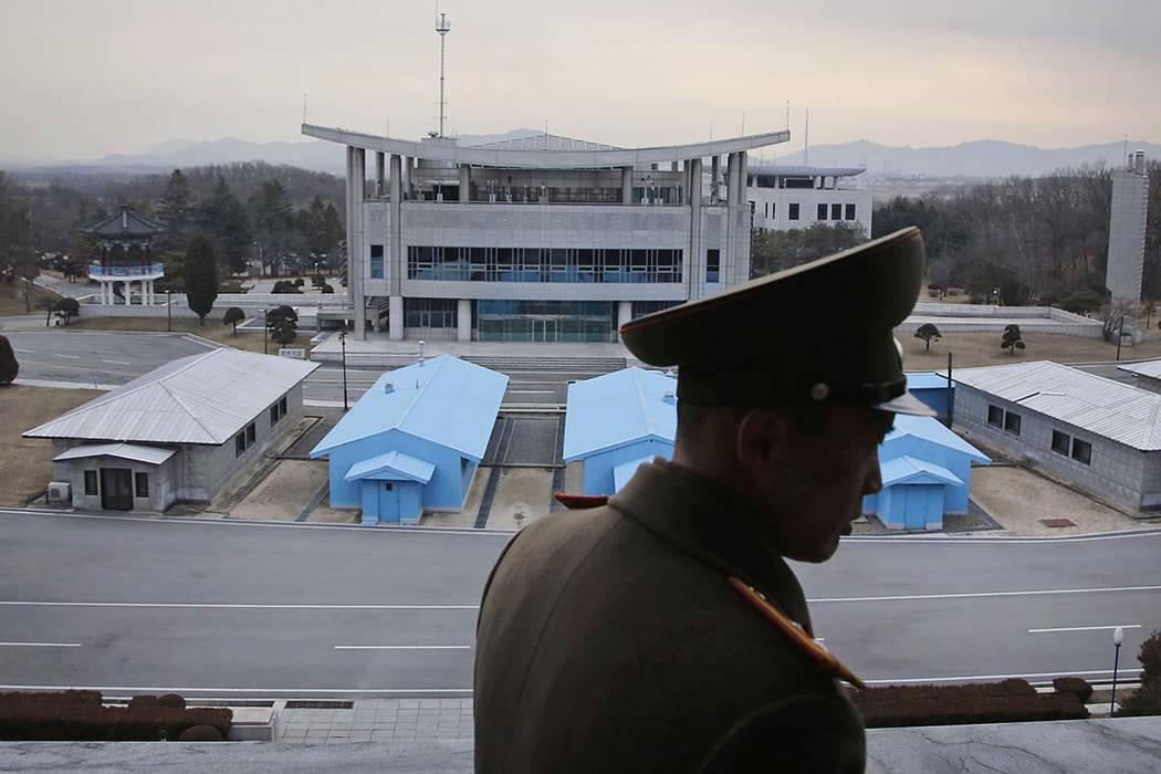 A North Korean army officer looks out at the Demilitarized Zone which separates the two Koreas, in Panmunjom, North Korea. The notion of a substantive sit-down between North Korean leader Kim Jong ...