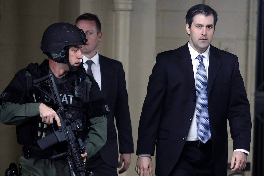 Former South Carolina police officer Michael Slager, right, walks from the Charleston County Courthouse under the protection of the Charleston County Sheriff's Department after a mistrial was decl ...