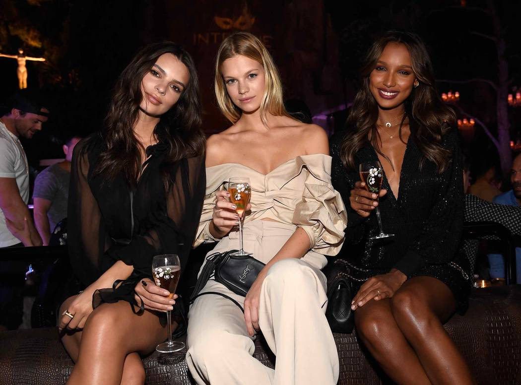 Emily Ratajkowski, Nadine Leopold and Jasmine Tookes celebrate at Intrigue Nightclub's First Anniversary Party hosted by Perrier-Jouet at Wynn Las Vegas early Friday, April 28, 2017, in Las Vegas. ...