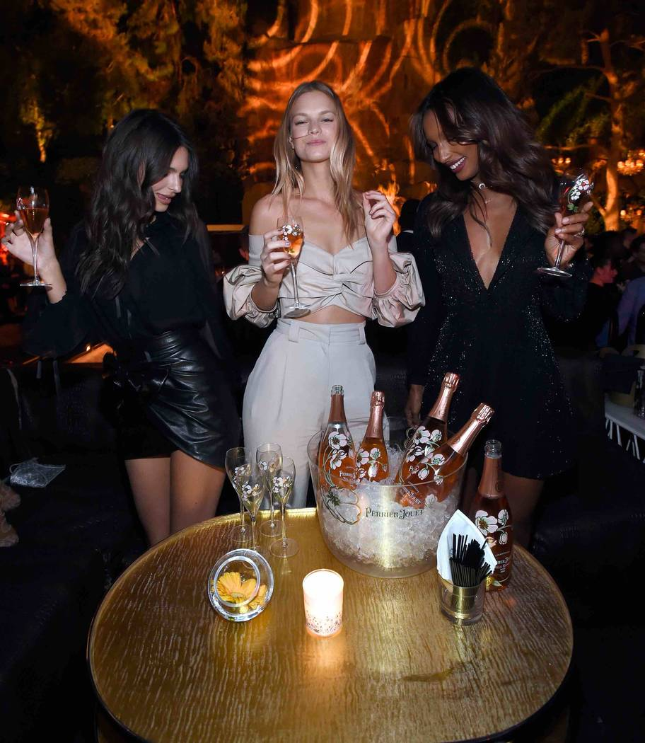 LAS VEGAS, NV - APRIL 28:  (L-R) Model/actress Emily Ratajkowski, models Nadine Leopold and Jasmine Tookes celebrate Intrigue Nightclub's One-Year Anniversary party hosted by Perrier-Jouet at Wynn ...