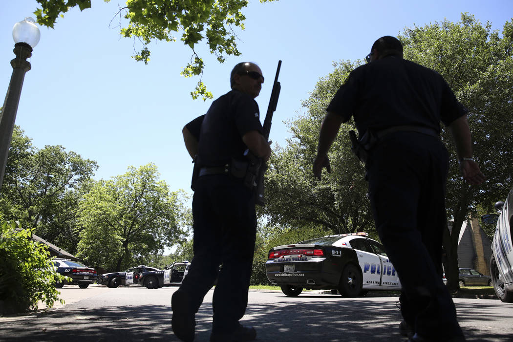 Dallas Police walk a neighborhood a block away from a shooting in Dallas, Monday, May 1, 2017. (LM Otero/AP)
