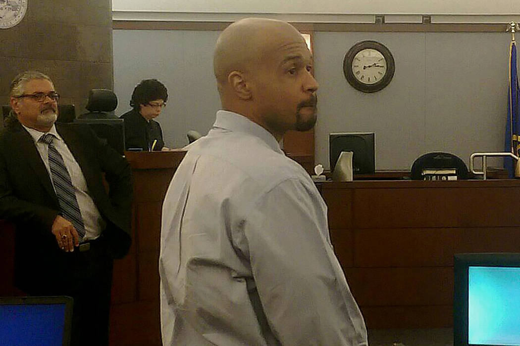 Shaun Leflore, 35, stands as the jurors enter the courtroom before opening statements. Leflore is charged with first-degree murder in the 2006 death of his girlfriend Chantell Hollowell. (Brooke W ...